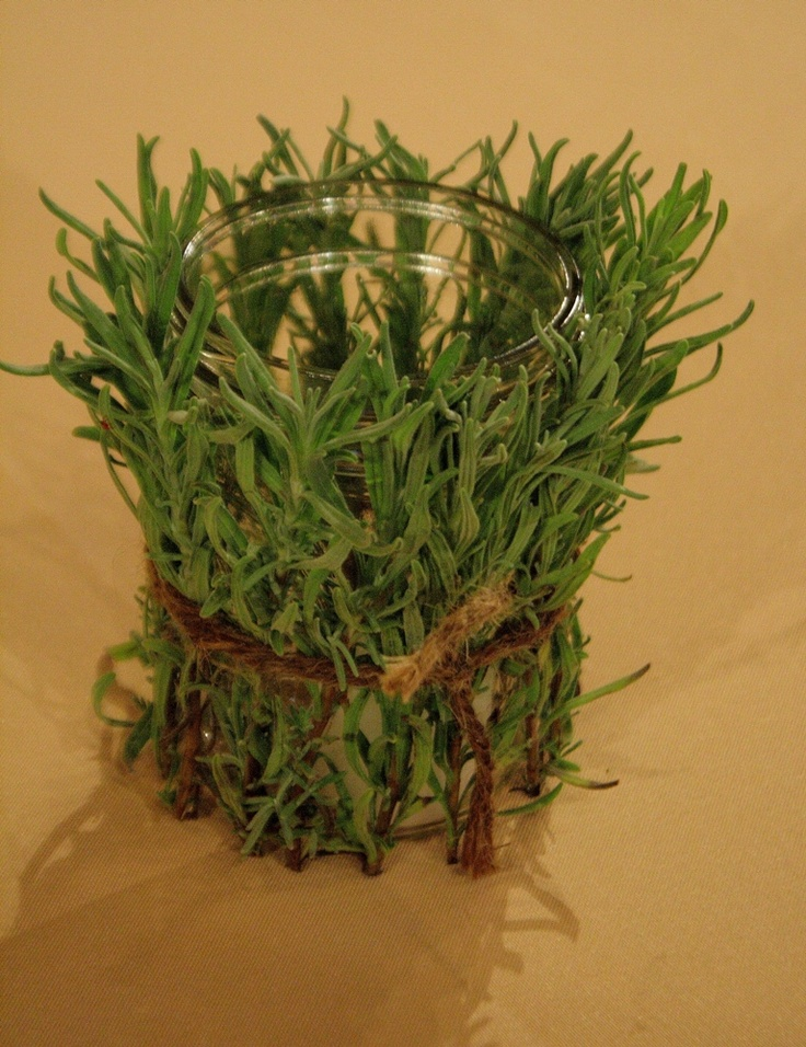 Lavender or rosemary foliage wrapped around candle for cocktail tables
