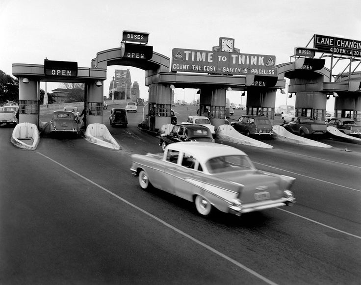 Traffic flowing smoothly on the Sydney Harbour Bridge after two new lanes were opened, July 1959