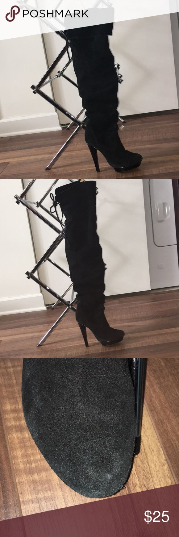 """Steve Madden over the knee boots Chic black suede over the knee boots with back tie. Can be worn 2 ways. Top part can be folded over or worn straight for a higher over the knee look. Does have signs of wear. Please see pictures. When wearing cannot notice the signs of wear. Great trendy boot that has already been broken in! 5in heel  1"""" platform 20"""" shaft with flap folded over  24.5"""" shaft fully extended Steve Madden Shoes Over the Knee Boots"""