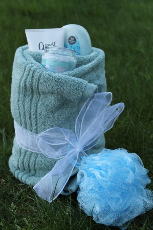 """**This would make a cute Bridesmaids Thank you gift, maybe in the Brides colors, or to match the color of the bridesmaids dresses!!** Towel, Body Soap, Lotion, Candle, Bath sponge, Ribbon, etc...could do same thing for the groomsmen only use aftershave, hand towel, fingernail clippers, etc...wrap it up with a bungy cord or strip of leather..you know, something """"manly"""" for them ;)"""