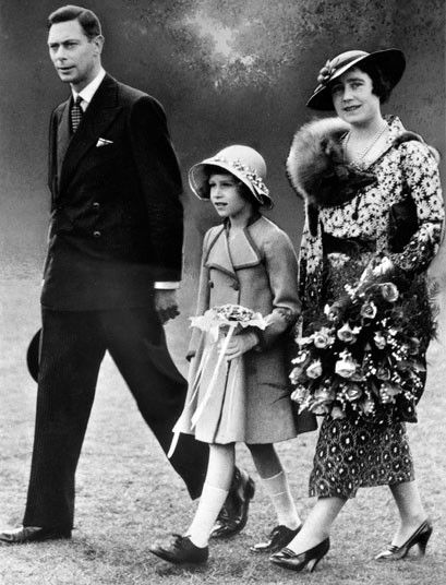 King George VI walks with the Queen Mother and Princess Elizabeth shortly after his coronation in 1937.