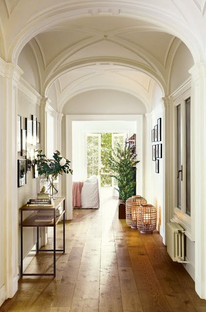 Amazing ceiling and wide plank floors in this corridor.