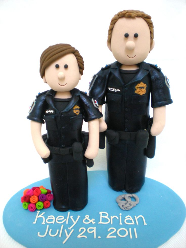 POLICE WEDDING CAKE TOPPERS.  Custom Police Officer Wedding with Handcuffs!  www.nicolewclark.com #police wedding #Policegroom #Policebride