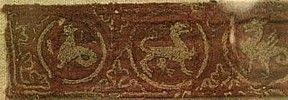 There are very few existent fragments of medieval embroidery remaining. A beautiful sample of can be seen below at left, on an embroidered band. The embroidery was sewn onto a separate strip of fabric which was then stitched to the garment. Dated at the 13th century, it is a band of fantastic animals in roundels embroidered with gold thread on silk twill. Photo ©Timothy Mitchell, Victoria Albert Museum of London. (Currently seeking permission to use image)