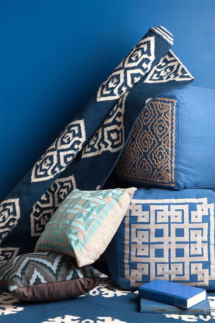 Blue and white accents Surya has pillows, poufs, and rugs to match your style home.