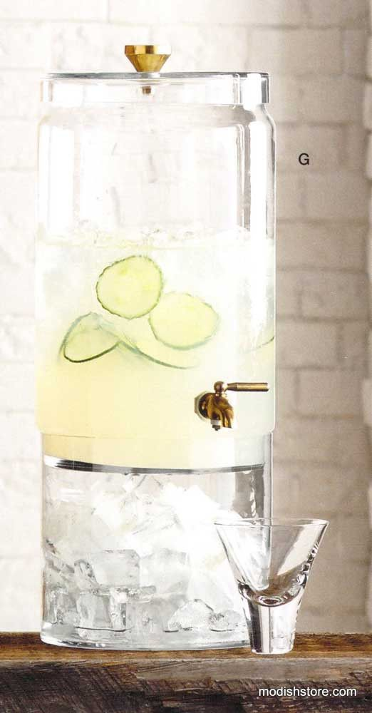 The Roost Bergen Glass & Brass Beverage Dispenser - This large capacity, mouth-blown glass beverage dispenser features a solid brass knob topper and spigot. You can add ice directly to the dispenser or to the separate bottom piece so beverages don't become diluted. Perfect for any party or gathering.                                                                                                                                                     More