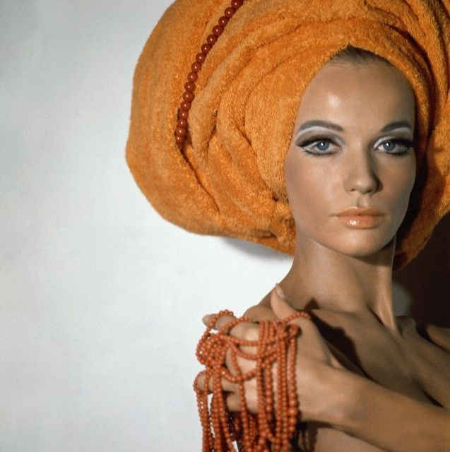 Rome 1967    With her hair up in an orange Martex towel, holding coral strands by Giovanni Apa.