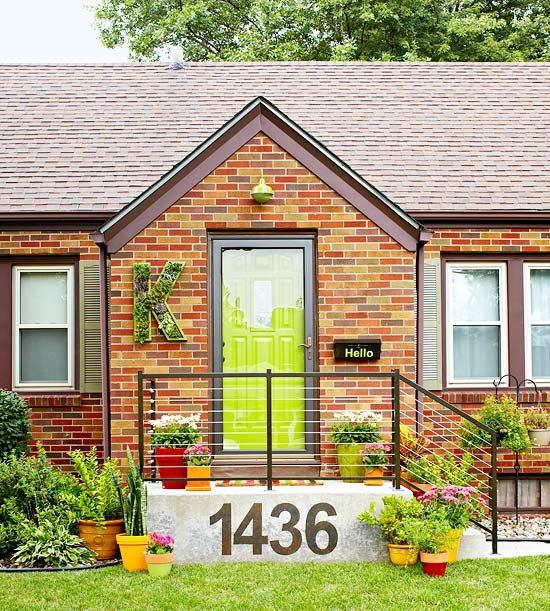 Green front door, monogram succulents, small porch, concrete house numbers. Plus 19