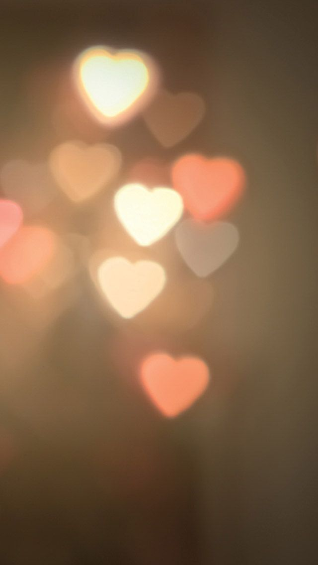 Glowing bokeh hearts smartphone wallpaper for Valentines day #valentinesday #love #wallpaper
