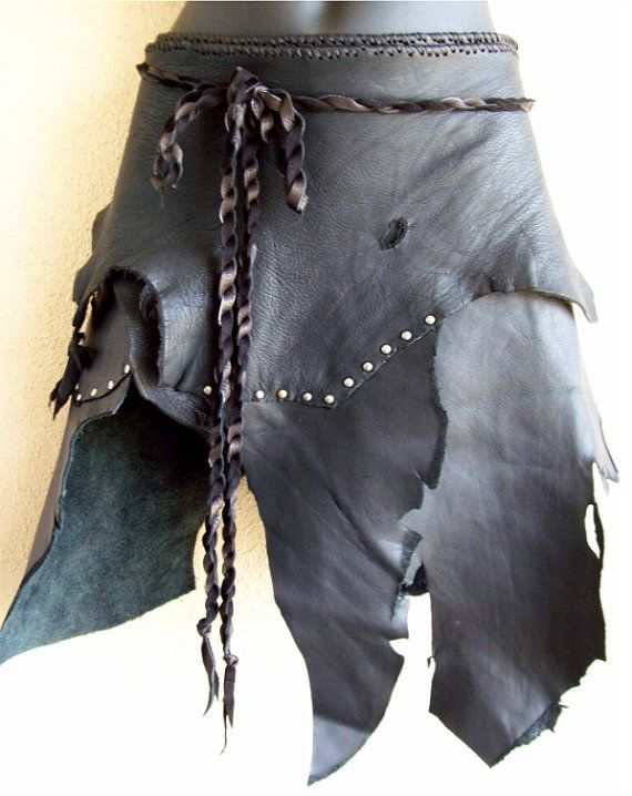 Made from raw edged scraps of black cowhide and deerskin with antique nickel hardware, this skirt fits anywhere from 30-36 waist or hips. Like the top its paired with? Its current;y for sale here: http://www.etsy.com/listing/74693329/dusty-brown-deerskin-bra Skirt ships in one of my handmade recyclable envelopes, as seen in the last picture. I live for custom designs, so feel free to ask for something special :)