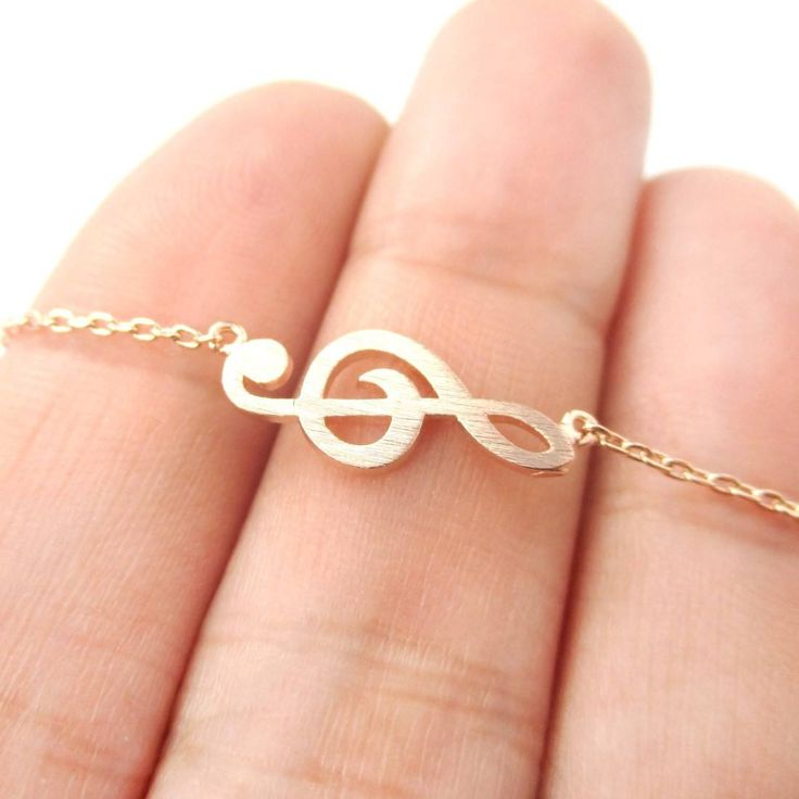 - Description - Details - Shipping A beautiful music themed necklace featuring a simple treble clef charm in rose gold! It is classic, pretty and a great gift for any music lover! More designs availab
