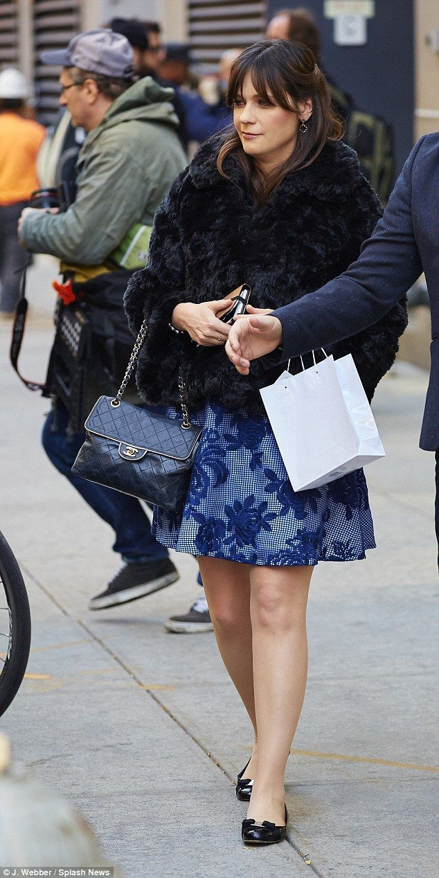Looking Otter-ly wonderful: The actress wore a blue dress and carried a Chanel bag after h...