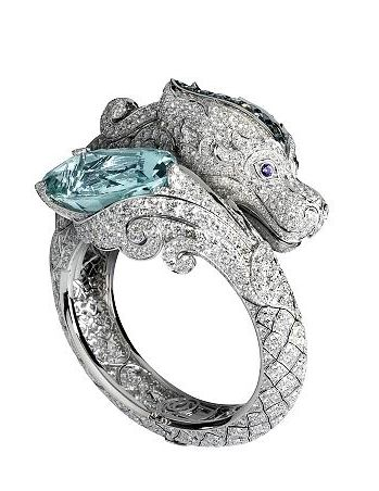 My boss was just telling me her friend had an engagement ring like this but the dragon was eating the diamond lol had to pin