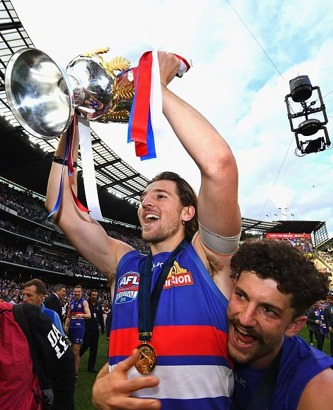 Marcus Bontempelli and Tom Liberatore of the Bulldogs celebrates with the trophy after winning the 2016 AFL Grand Final match between the Sydney...