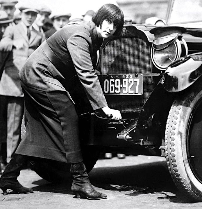 Maude Odell, cranking her car, was one of the first female cab driver in NYC c.1923 Photograph: Bettmann/Corbis ""