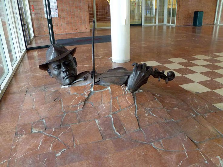 The destructive fiddler What it is: A giant man playing the violin has been busting open the floor of the Stopera, Amsterdam's City Hall/ope...