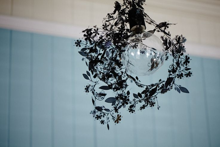 Black Garland lighting, light blue walls pendant feature light