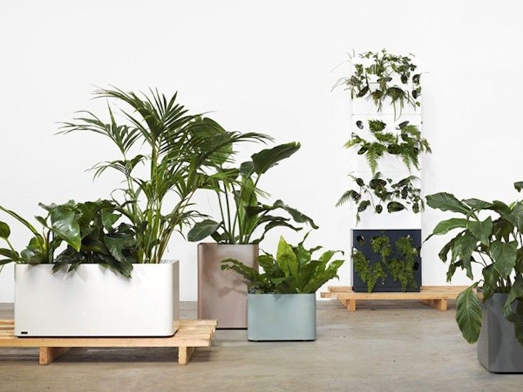 Tait's powder-coated steel Softline Planters feature hidden casters for easy portability.