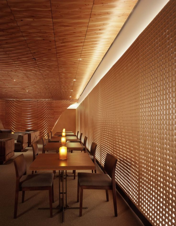 Minimal restaurant design. Good use of corrugated material on walls which let through small amounts of light