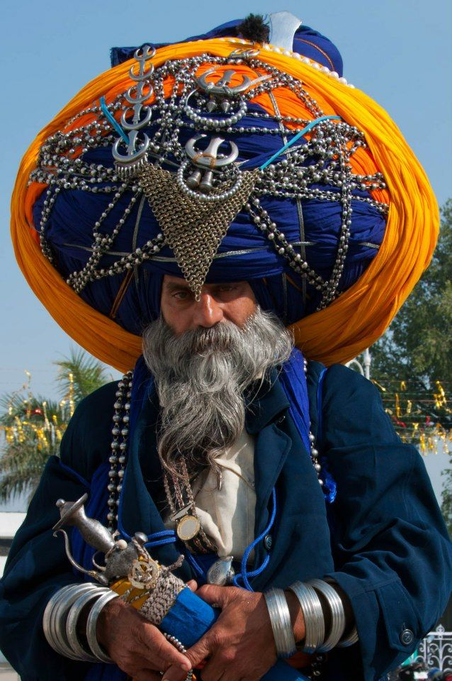 Sikh man at the Golden Temple in Amritsar, India. Length of his turban? 200 meters. Photograph by Aaron Goccia
