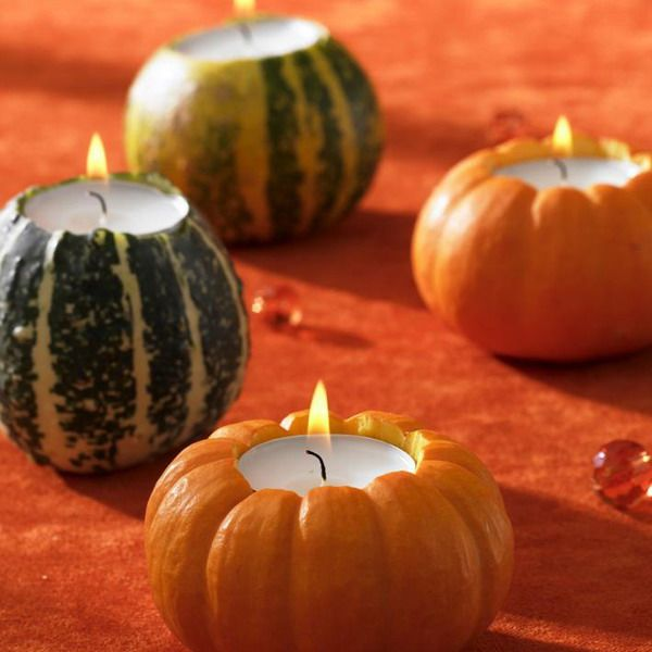 Use small pumpkins or apples to make candle holders. Remove the center of the apple or pumpkin then insert the candles.