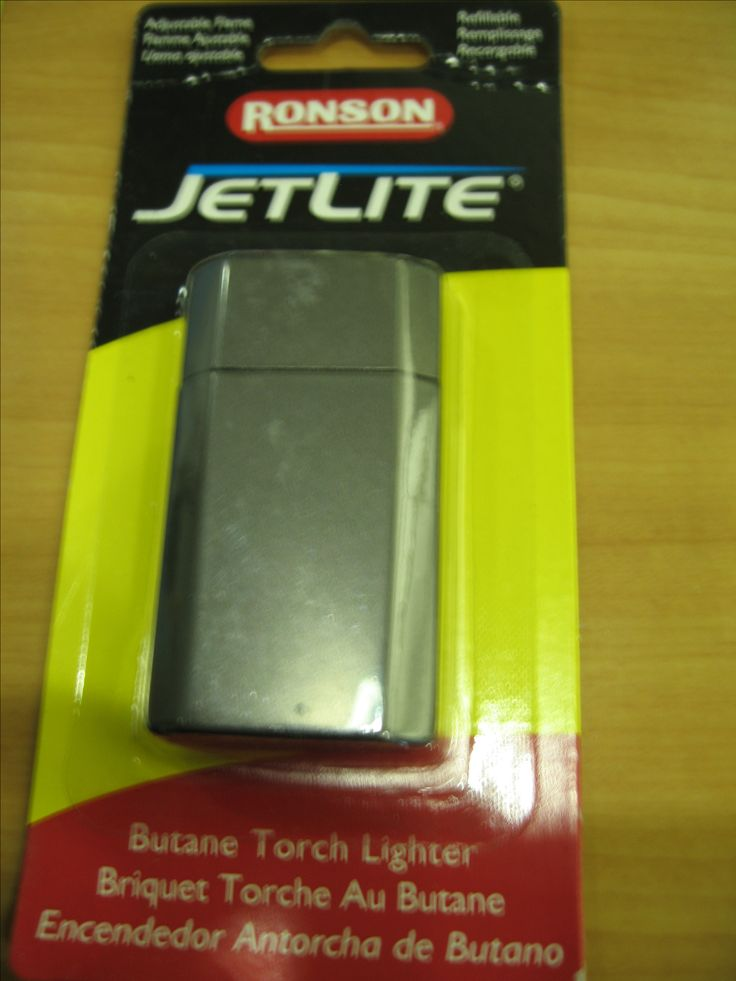 Adjustable Flame Flamme Ajustable Llama ajustable  Refillable Remplissage Recargable  RONSON(R)  JETLITE (R)  Butane Torch Lighter Briquet Torche Au Butane Encendedor Atorcha de Butano  Model:  JETLITE * Part No. 43511 Made in China * Fabriqu`e en Chine * Fabricado en China  www.RonsonUSA.com  Ronson is a registered trademark of Zippo Manufacturing  Company.  All Rights Reserved  sku 037900435113  Zippo Manufacturing Company Bradford, PA 19701 USA