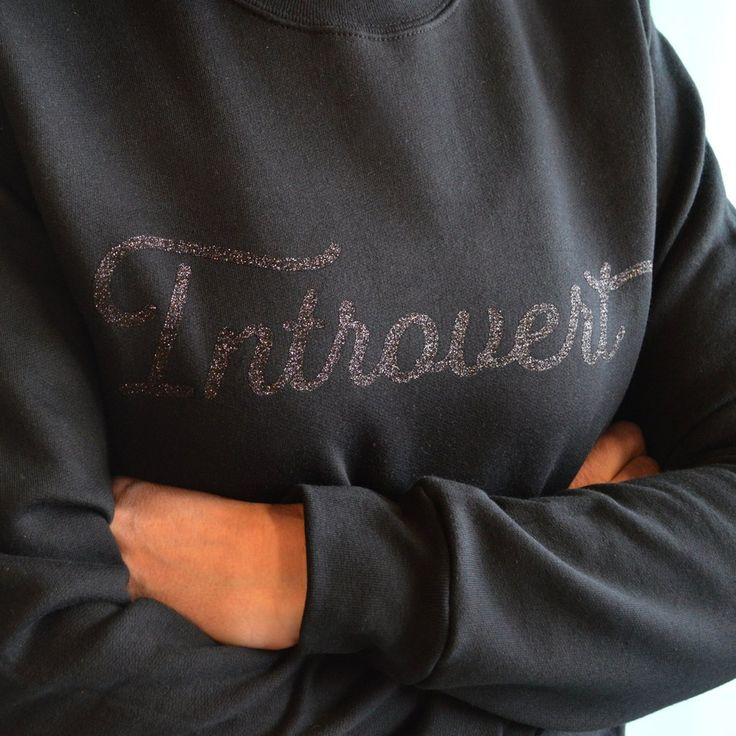 "A subtle yet sparkly ""Introvert"" design. Safe for washer & dryer.Featuring Fairwater Script by Laura Worthington.Unisex crew cut sweatshirt.   Maker Fairgoo"