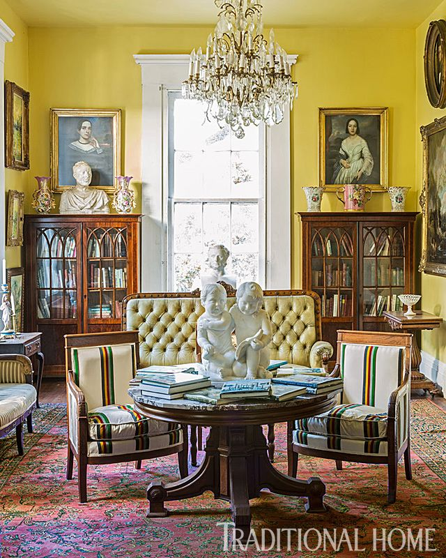Bright Yellow Walls And Bountiful Artwork Enliven This Study