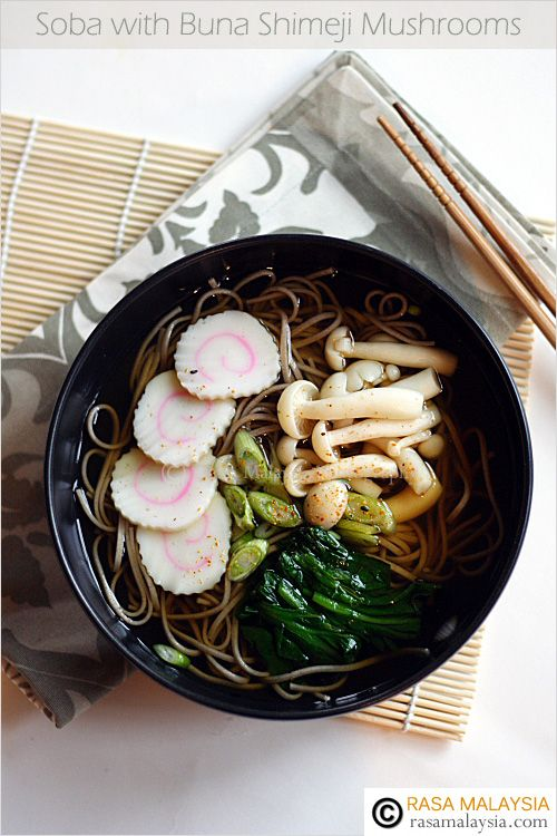 "Soba (Japanese Buckwheat Noodle) recipe - I made soba or Japanese buckwheat noodle soup, topped with my favorite Japanese fish cake ""naruto"" (don't you just love the pink swirl?), boiled spinach, and some buna shimeji mushrooms. It was so good I slurped it dry! #japanese #noodles"