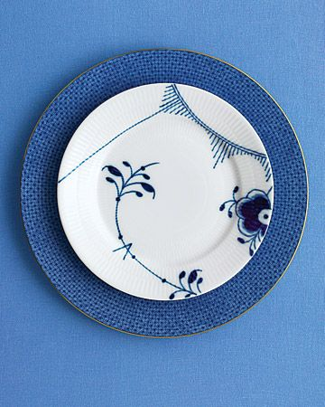 "Pattern Play: If you're tonally challenged, stick to one palette -- but contrast decorative elements such as botanicals with geometrics. ""Blue Fluted Mega"" bread-and-butter plate, Royal Copenhagen; ""Blue Lace"" dinner plate, Mottahedeh."