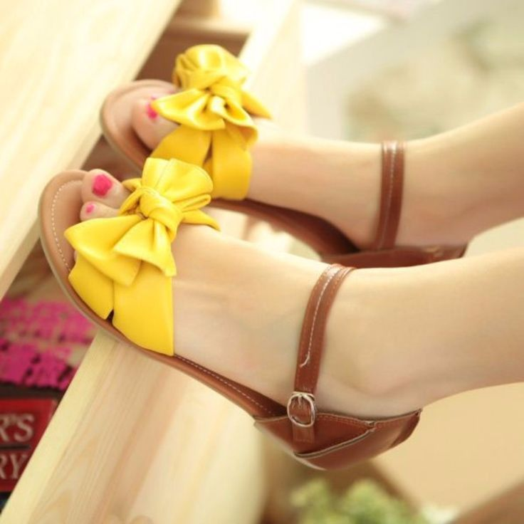 Slip on with this flat sandals that is great for walking. This pair fetaures cover heel with ankle strap, lovely butterfly bowknot on the vamp and flat heels. Crafted from rubber, PU and soft leather