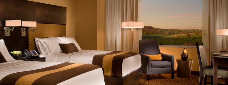 Traverse City Michigan Hotels   Turtle Creek Casino & Hotel- 300 square feet of casual contemporary elegance. King or two extra-long double beds are covered in crisp white linen. Bathroom counter-tops are golden amber granite. Includes 37-inch LCD television.