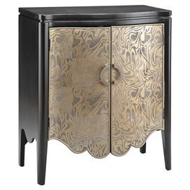 Hand-painted black wood cabinet with two metallic gold doors and crescent hardware.    Product: CabinetConstruction Material: WoodColor: Black and textured gold metallicFeatures:  Hand-paintedCrescent hardwareOne interior adjustable shelfTwo doors Dimensions: 36 H x 32 W x 16 D