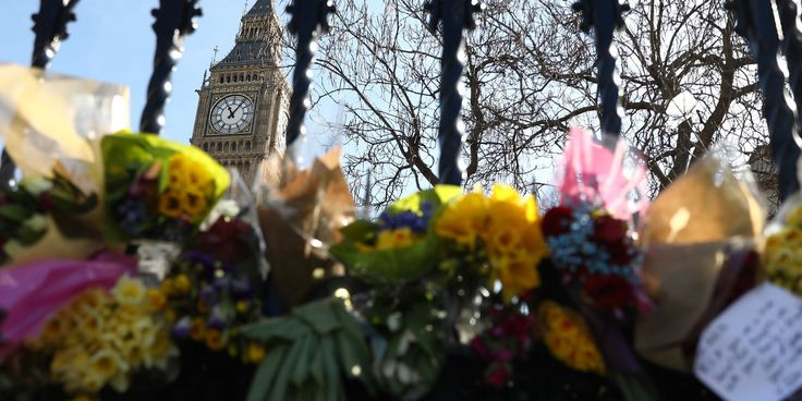 (NEIL HALL / REUTERS) Westminster Attack: 30-Year-Old Man Arrested In Birmingham Police raided property in city where friends of Khalid Masood live. Floral tributes are tied to a fence in Parliament Square following the attack in Westminster earlier in the week, in central London.