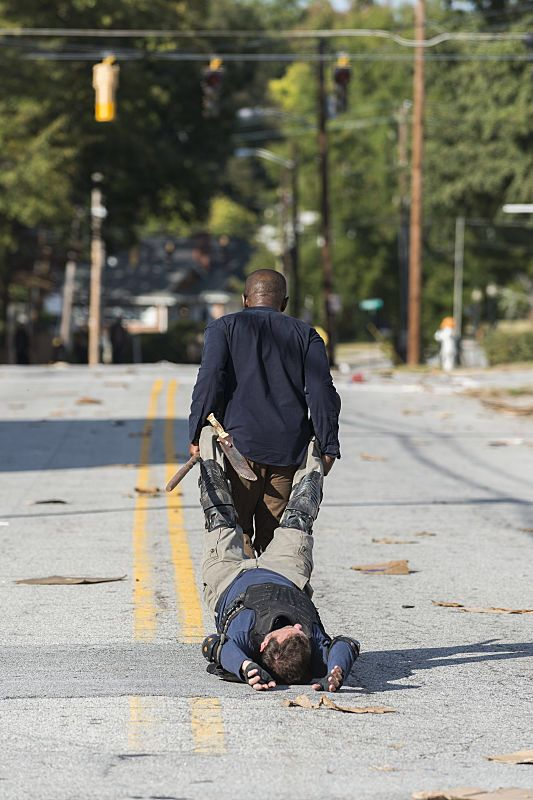 """Morgan carrying Richard to his grave. The Walking Dead Season 7 Episode 13 """"Bury Me Here."""" TWD S07 E13."""