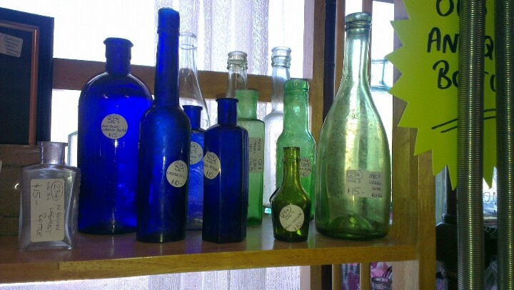 More antique bottles, blue and green.