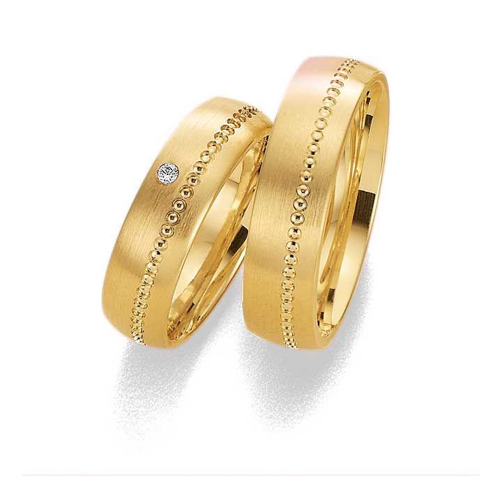 trouwringen van goud met diamant  http://isis-jewels.nl/index.php/trouwringen-relatieringen.html