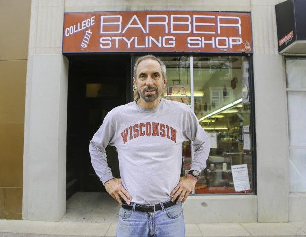 College Barber Shop, 665 State Street, Madison, Wisconsin, closed in September 2014 after nearly 9 decades in business under three ownerships. Fred Lee opened it in 1928, then Don Fine took over in 1969. Larry Cobb (above) started cutting hair at the shop in October 1978, and he and a partner acquired it in 2007. Fine kept working there part time until closing, racking up more than 60 years in the trade at age 84. (Joey Reuteman photo)