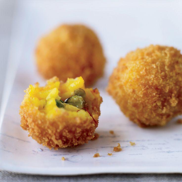 """This recipe for arancini—fried risotto balls—comes from Renato Poliafito, who got it from his Sicilian cousin Emanuele Sanfilippo. """"Renato is obse..."""