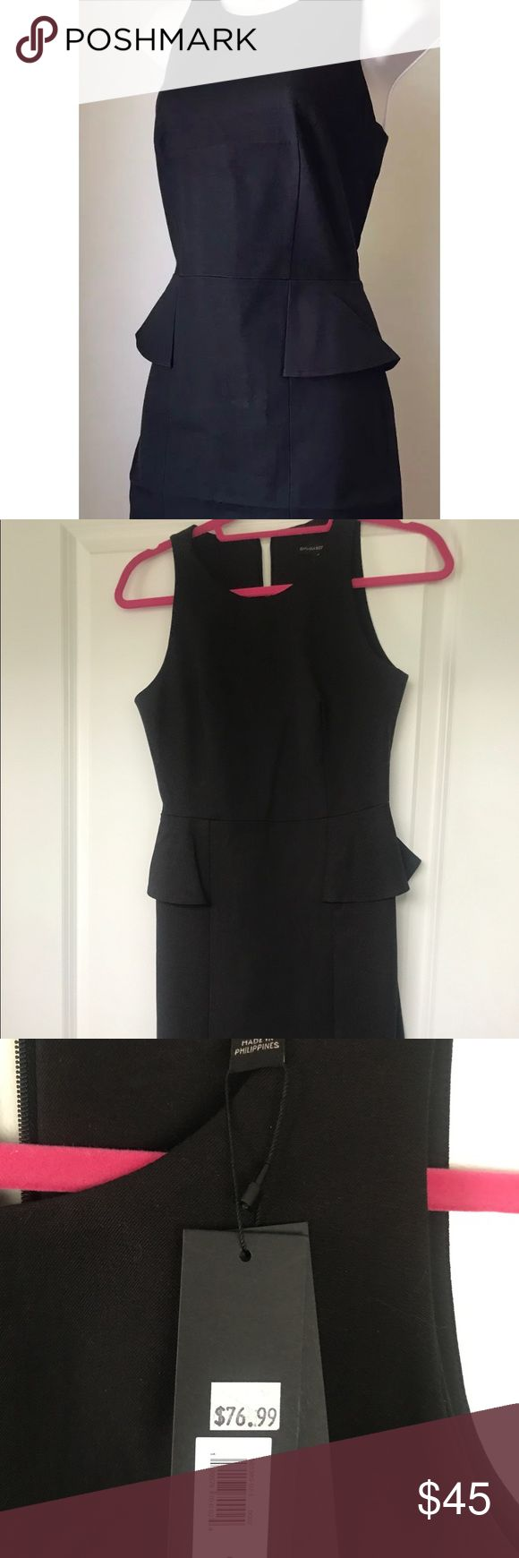 NWT Banana republic black peplum dress Sz 2 NWT black sheath dress with peplum accent at side waist, crew neck, stretchy material , tailored fit, zipper in back, vented front slits, hits at knee, size 2 Banana Republic Dresses