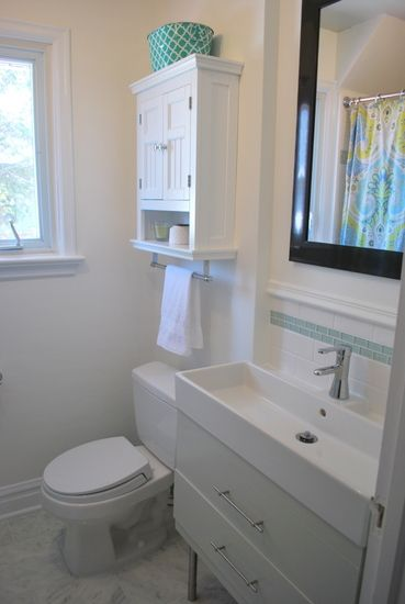 Longer vanity, put color in as a trim tile.  Colored ceiling for illusion of height.