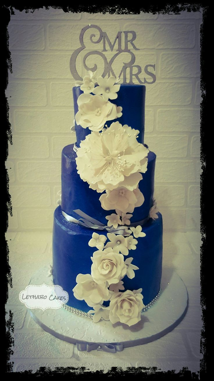 Royal blue and white  with a touch of silver. Edible sugar flowers xx