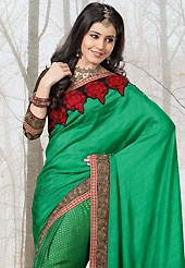This season dazzle and shine in pure colors. This green raw silk and viscose saree have beautiful embroidery patch work which is embellished with resham, zari, stone and lace work. Fabulous designed embroidery gives you an ethnic look and increasing your beauty. Contrasting black viscose blouse is available. Slight Color variations are possible due to differing screen and photograph resolutions.
