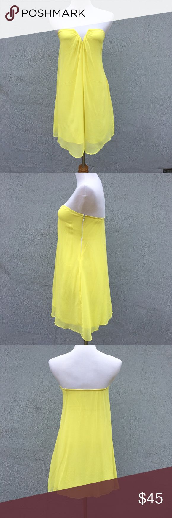 Elizabeth and James Silk Strapless Mini Dress SM Elizabeth and James Silk Strapless Mini Dress SIze Small. Bright yellow with a white side zipper, and deep v. Has some flaws throughout (small snags, please see up-close photo), and the V has been mended with thread (not visible when wearing). This also has been washed so it has a slight stiffness to it but is still very soft. Has built in straps for hanging, but the dress is meant to be worn strapless. Thank you for stopping by. Elizabeth and…