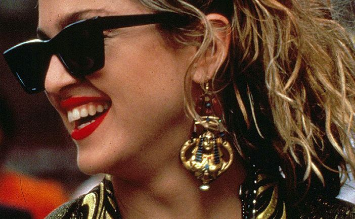 1985 - giant gold tone Egyptian pharaoh earrings. Madonna in Desperately Seeking Susan