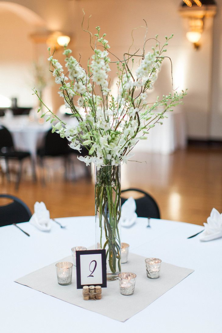 White delphinium and branch wedding centerpieces always