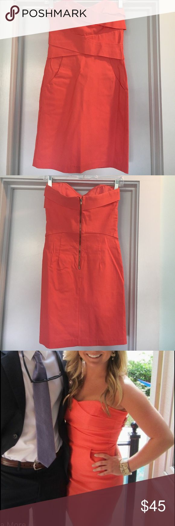 Coral Cocktail Dress! Awesome dress for an event or nice night out! Total hit when I wore it to my events. Coral, form fitting, strapless dress. Criss-Cross pattern in front. Has pockets and zips up in the back! Dresses Strapless