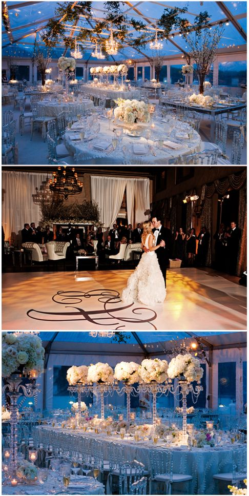 Gorgeous wedding, clear tent, with high and low flower arrangements and hanging greens.
