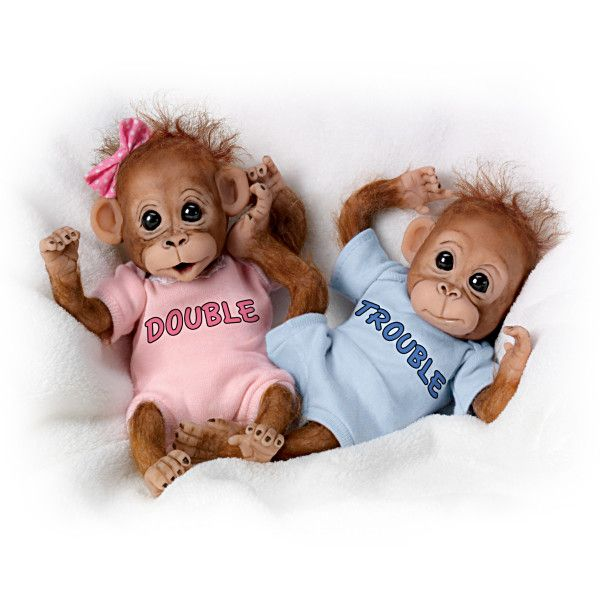 Double Trouble Poseable Baby Orangutan Twins  Fill your heart with laughter and delight with the Double Trouble orangutan baby doll set, the first-ever monkey doll twins from The Ashton-Drake Galleries!  This twin doll set looks so real with soft wisps of hand-applied hair, along with realistic features, that you'll need to be on mischief alert all day!