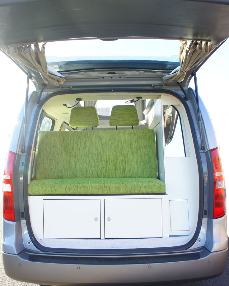 Hyundai campervan conversion with white ply and grass green upholstery.